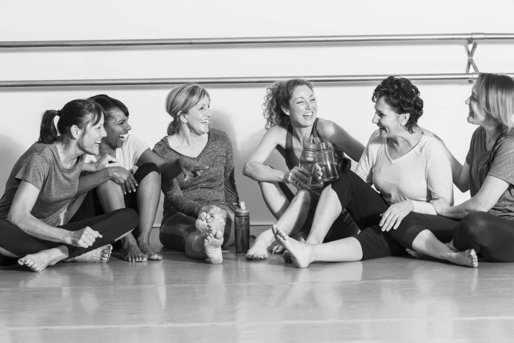 Women in exercise class, taking break